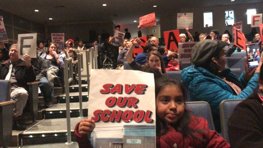 Members and supporters of the Coalition to Defend Lincoln Annex School are pictured at the Feb. 25 New Brunswick Board of Education meeting.