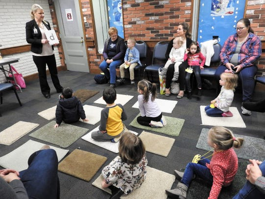 Cyndi Shutt leads the Letterland program for preschool students and their guardians at the Coshocton Public Library. While children's programming was down slightly in 2019, overall programming was up with big increases for teens and adults.