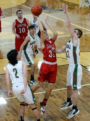 Abe Jarvis goes up for a shot in the lane during Coshocton's 65-56 loss to host Barnesville in a Division III sectional game last season. Jarvis is one of three returning lettermen for the Redskins, who open play on Tuesday against Danville.