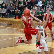 Gaven Williams flies through the lane during Coshocton's 65-56 loss to host Barnesville in a Division III sectional game on Tuesday night.