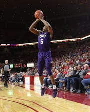 TCU Horned Frogs guard Jaire Grayer (5) shoots against the Iowa State Cyclones at Hilton Coliseum on Tuesday. Grayer is the son of Iowa State career scoring leader Jeff Grayer (1984-88).