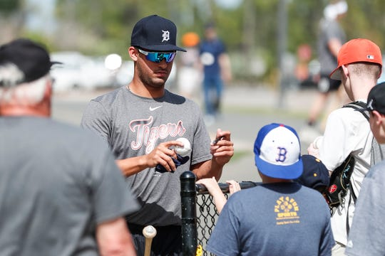 Outfielder Riley Greene signs autographs for fans during Detroit Tigers spring training at TigerTown in Lakeland, Fla., Tuesday, Feb. 18, 2020.