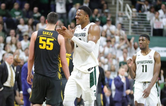 Michigan State Spartans forward Xavier Tillman (23) claps after a stop against Iowa Hawkeyes during second half action Tuesday, February 25, 2020 at the Breslin Center in East Lansing, Mich.