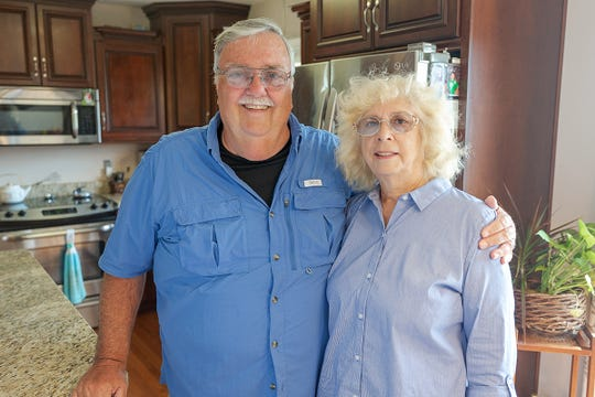 Genesee County residents Verle Gilbert Jr. (left) and Cynthia Gilbert inspire their family's younger generation to attend college by establishing college savings accounts.