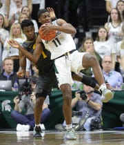 Michigan State Spartans forward Aaron Henry (11) rebounds against Iowa Hawkeyes guard Bakari Evelyn (4) during first half action Tuesday, February 25, 2020 at the Breslin Center in East Lansing, Mich.