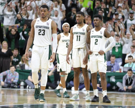 Michigan State Spartans forward Xavier Tillman (23) guard Cassius Winston (5), forward Aaron Henry (11) and guard Rocket Watts (2) during action against the Iowa Hawkeyes Tuesday, February 25, 2020 at the Breslin Center in East Lansing, Mich.