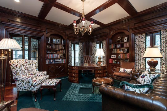 The 19-by-18-ft library is paneled with heavily carved aged mahogany that builder Hilary Micou saved from another building. Other components here include a Versailles style wood floor from the former home of Henry Ford II.  Photographed in Bloomfield Hills, Tuesday, Feb. 25, 2020.