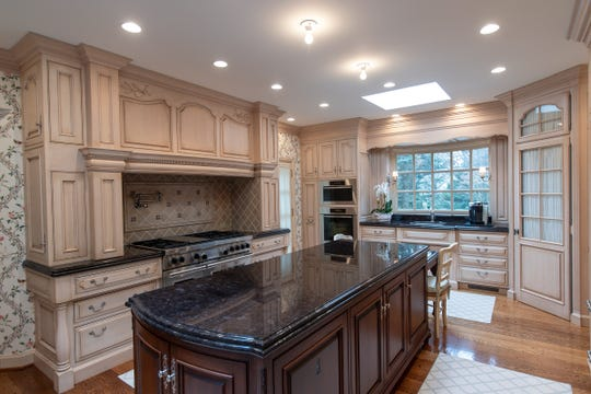 The long, French-style kitchen has three of the bay window's called oriels.The one seen in the rear here has a counter and sink set in. The kitchen includes two dishwashers, too warming drawers and other Wolf and Meile appliances. Photographed in Bloomfield Hills, Tuesday, Feb. 25, 2020.