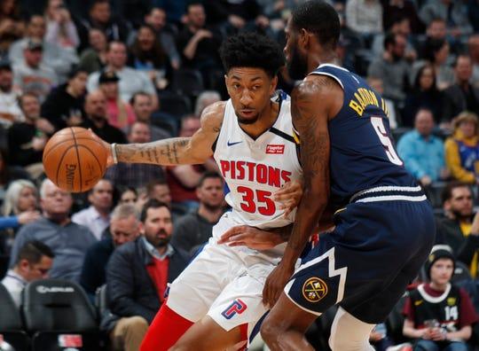 Detroit Pistons' Christian Wood drives past Denver Nuggets' Will Barton on Feb. 25, 2020, in Denver.