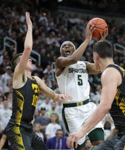 Michigan State Spartans guard Cassius Winston (5) drives against the Iowa Hawkeyes during second half action Tuesday, February 25, 2020 at the Breslin Center in East Lansing, Mich.
