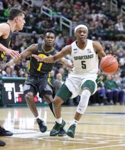 Michigan State Spartans guard Cassius Winston (5) drives against Iowa Hawkeyes guard Joe Toussaint (1) during first half action Tuesday, February 25, 2020 at the Breslin Center in East Lansing, Mich.