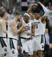 Michigan State Spartans guard Kyle Ahrens (0) and Michigan State Spartans guard Cassius Winston (5) react after a stop against the Iowa Hawkeyes Tuesday, February 25, 2020 at the Breslin Center in East Lansing, Mich.