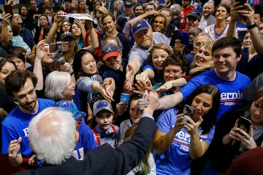Supporters greet Democratic presidential candidate Sen. Bernie Sanders, I-Vt., bottom left, at a campaign event, Wednesday, Feb. 26, 2020, in North Charleston, S.C.