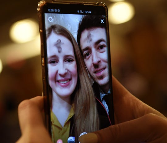 Madeline Lorio, 21 and Francisco Javier Hernandez, 35, take a selfie of their ashes to post on social media.