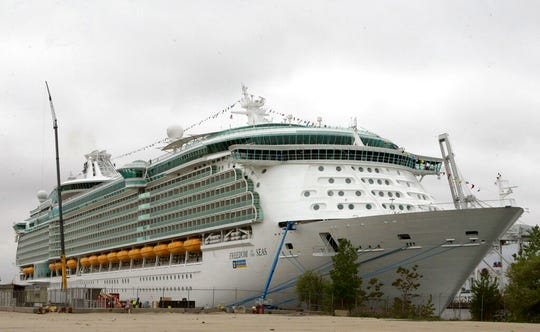 "This May 11, 2006 file photo shows the Freedom of the Seas cruise ship docked in Bayonne, N.J. An Indiana man charged with negligent homicide in his granddaughter's fatal plunge from a cruise ship docked in Puerto Rico insists that he didn't realize an 11th-floor window was open before the 18-month-old fell to her death in July. Salvatore Anello of Valparaiso tells ""CBS This Morning"" that Chloe Wiegand fell after he lifted her to a window on the Royal Caribbean's Freedom of the Seas so she could bang on the glass like she did at hockey games."