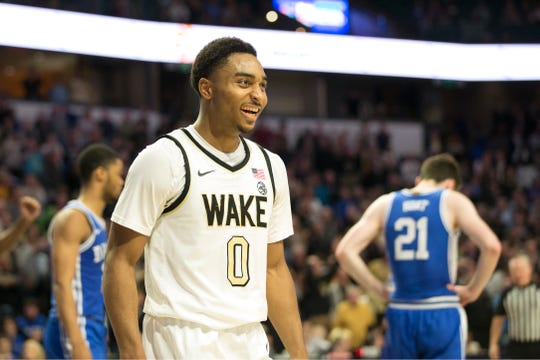 Wake Forest guard Brandon Childress (0) is all smiles in double overtime against Duke, Tuesday.  Brandon Childress hit a tying 3-pointer late in regulation and finished with 17 points to help Wake Forest stun seventh-ranked Duke 113-101 in double overtime.