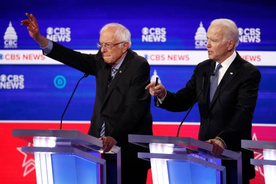 Democratic presidential candidates Sen. Bernie Sanders, left, I-Vt., and former Vice President Joe Biden participate in a Democratic presidential primary debate at the Gaillard Center, Tuesday, Feb. 25, 2020, in Charleston, S.C.