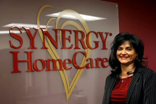 In this Feb. 20, 2020, photo Saili Gosula, executive director of SYNERGY HomeCare of San Mateo, poses for a photo at her office in San Mateo, Calif. Gosula has a remote administrative staffer and several onsite employees at her Synergy HomeCare franchise.