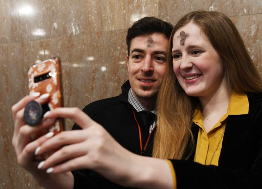 Francisco Javier Hernandez, 35, and Madeline Lorio, 21, take a selfie of their ashes to post on social media.