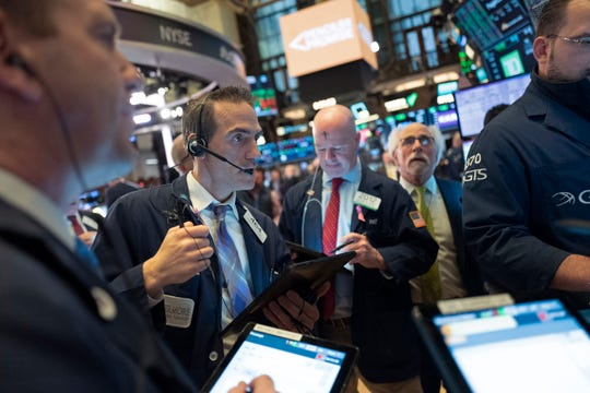 Stock traders work at the New York Stock Exchange, Wednesday.