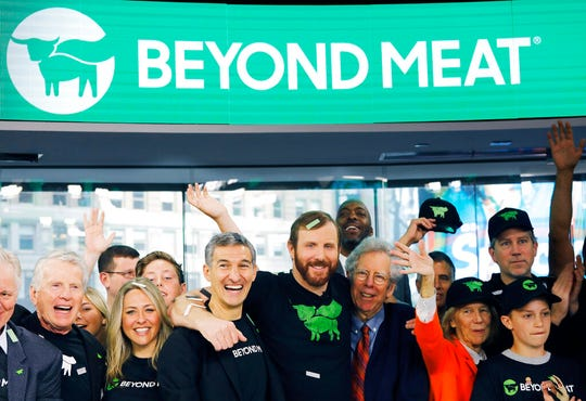 Ethan Brown, center, CEO of Beyond Meat, attends the Opening Bell ceremony with guests to celebrate the company's IPO at Nasdaq in New York on May 2, 2019.