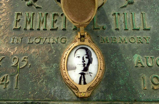 This May 4, 2005, file photo shows Emmett Till's photo on his grave marker in Alsip, Ill. Sixty-five years after 14-year-old Emmett Till was lynched in Mississippi, Congress is set to approve legislation designating lynching as a hate crime under federal law.