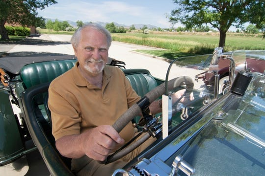 Author Clive Cussler riding in a classic car in 2007. Cussler died on Monday, Feb. 24, 2020 at his home in Scottsdale, AZ. He was 88.