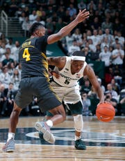Michigan State point guard Cassius Winston, right, scored 19 of his 20 points in the second half Tuesday night against Iowa.