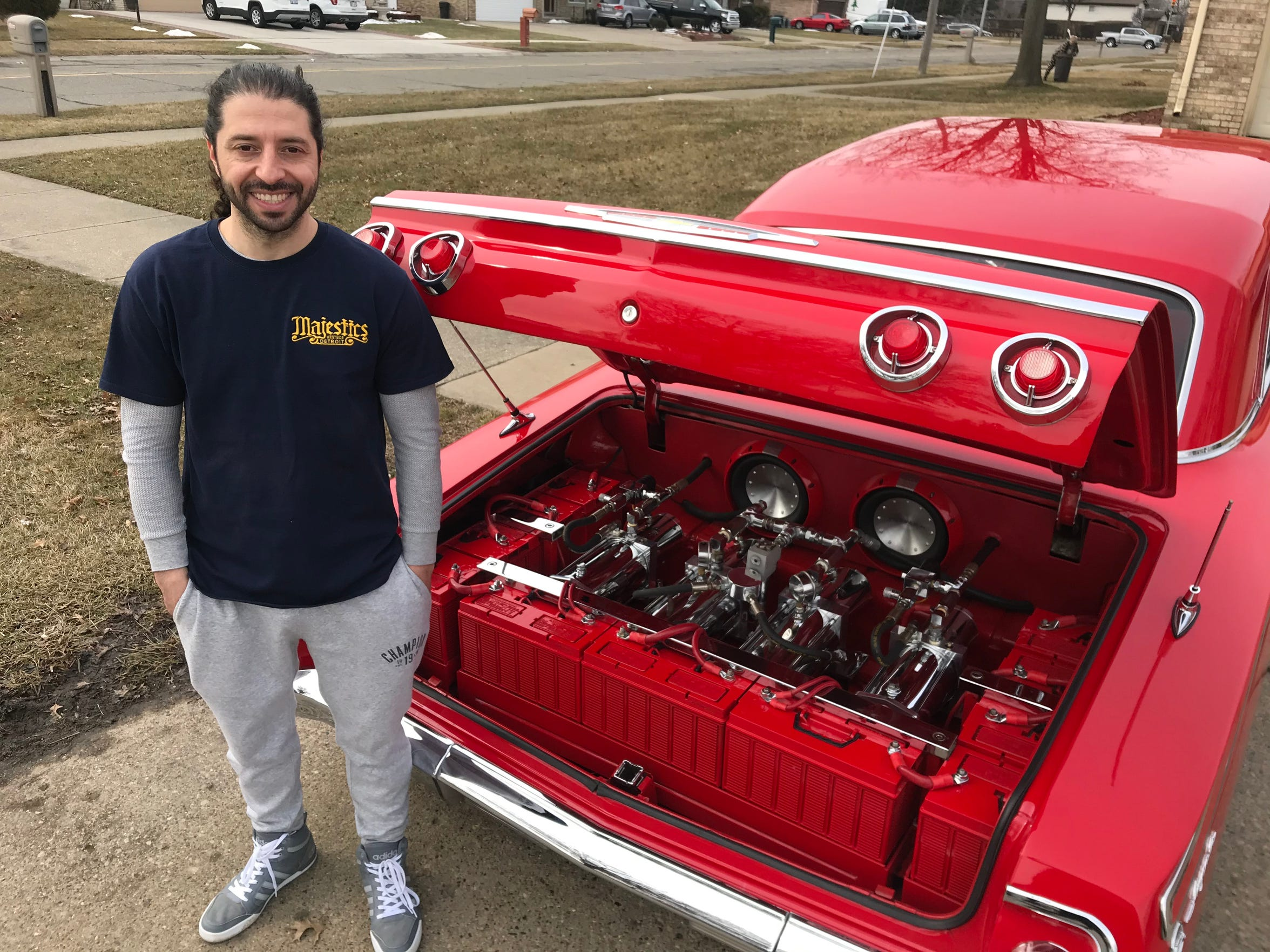 Ferras Sabo, 39, of Sterling Heights shows off his customized 1962 Chevrolet Impala lowrider. The trunk is packed with hydraulic pumps that can raise any of the four corners independently and even cause the car to hop.