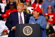 President Donald Trump speaks alongside Mike Eruzione, captain of the 1980 U.S men's Olympic hockey team, during a campaign rally, Friday, Feb. 21, 2020, in Las Vegas. Trump's campaign is stepping up its outreach to black Americans as it tries to claw away support from the traditionally Democratic voting bloc ahead of November's general election.
