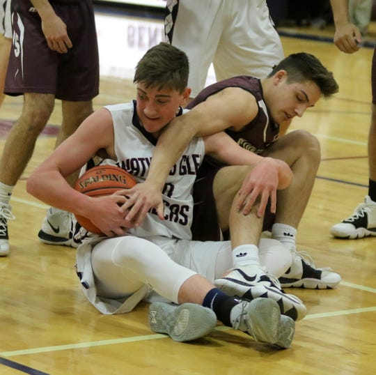 Watkins Glen's Jacob DeJong (left) and Sidney's Liam Matthews battle for possession during the Senecas' 52-32 win in the first round of the Section 4 Class C boys basketball tournament Feb. 25, 2020.