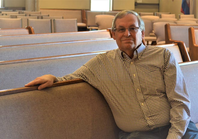 Steve Lamale sits in the sanctuary of Fremont Alliance Church where he serves as elder and worship leader.