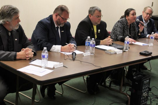 Congressional candidates in Ohio's 4th District took part in a debate Tuesday night at Birchard Public LIbrary. Candidates in attendance were, from left, independent Chris Gibbs, Democrat Jeffrey Sites, Libertarian Steve Perkins, Democrat Shannon Freshour, and Democrat Mike Larsen.