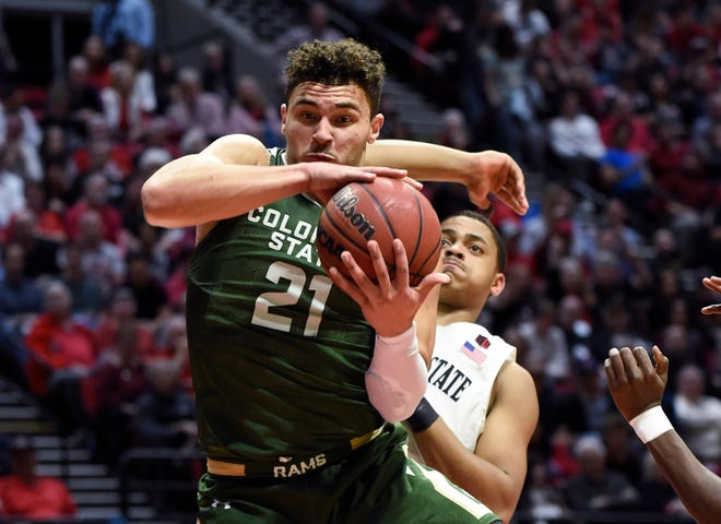 Colorado State guard David Roddy (21) grabs a rebound in front of San Diego State forward Matt Mitchell during the second half of an NCAA college basketball game Tuesday, Feb. 25, 2020, in San Diego.