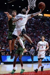Feb 25, 2020; San Diego, California, USA; San Diego State Aztecs guard KJ Feagin (10) goes to the basket defended by Colorado State Rams guard David Roddy (21) during the second half at Viejas Arena.