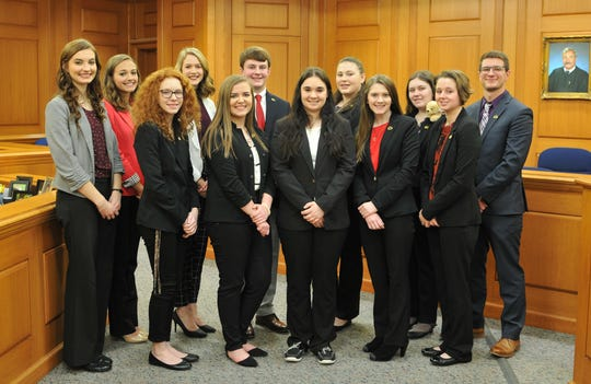 The Luxemburg-Casco High School mock trial team, with teacher coach Andreau Enderby at far right, in the courtroom for the regional tournament Feb. 25 in La Crosse, where it finished third, one place away from qualifying for the state high school tournament.