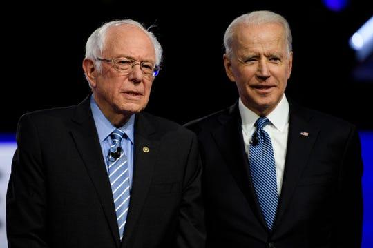 Democratic presidential candidates Bernie Sanders and Joe Biden during the South Carolina Democratic debate in Charleston Tuesday, Feb. 25, 2020.