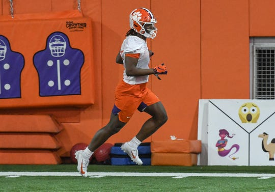 Clemson runningback Travis Etienne(9) runs after a catch during Spring practice in Clemson Wednesday, February 26, 2020.