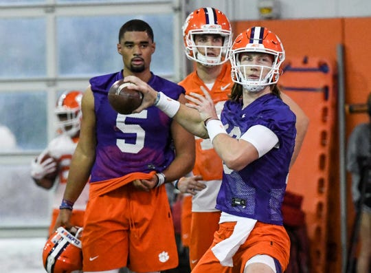 Clemson quarterback Trevor Lawrence(16) passes a ball near  quarterback D.J. Uiagalelei(5) during Spring practice in Clemson Wednesday, February 26, 2020.