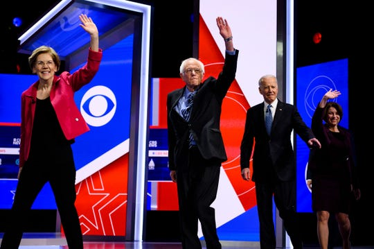 Democratic presidential candidates Elizabeth Warren, Bernie Sanders, Joe Biden and Amy Klobuchar walk onto the stage during the South Carolina Democratic debate in Charleston Tuesday, Feb. 25, 2020.