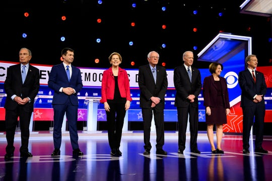 Democratic presidential candidates Michael Bloomberg, Pete Buttigieg, Elizabeth Warren, Bernie Sanders, Joe Biden, Amy Klobuchar and Tom Steyer walk onto the stage during the South Carolina Democratic debate in Charleston Tuesday, Feb. 25, 2020.
