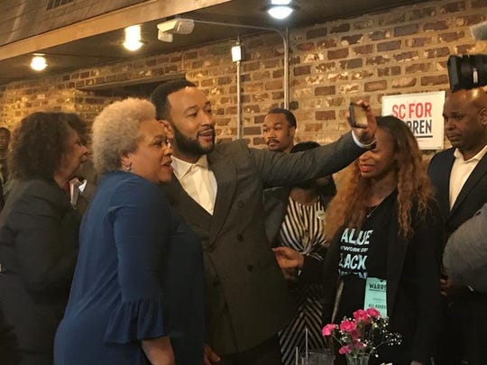 Musician John Legend's showed up at D&B Fried Fish and Barbecue Wednesday to support U.S. Sen. Elizabeth Warren's candidacy for president, at the South Carolina State University, Feb. 26, 2020.