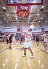 Center Grove senior Liam Price (35) scores the first points in Tuesday's game against  Brownsburg. Price was honored on the school's Senior Night.