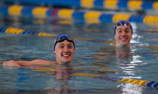 Carmel Swimmers Wyatt Davis, left, and Jake Mitchell, right, pose for IndyStar at Carmel High School, Carmel, Ind., Wednesday, Feb. 26, 2020.