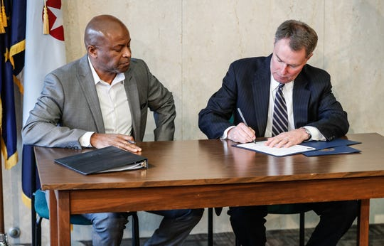 Indianapolis Mayor Joe Hogsett, right, City-County Council President Vop Osili, hold a press conference and bill-signing ceremony for the city's new protections for renters after the passage of  proposals 40 and 41, at the City-County Building on Wednesday, Feb. 26, 2020.