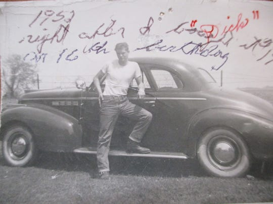 RichardVitosh poses outside the car he got for his 16th birthday in Iowa City on March 1, 1952.