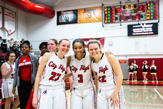 Iowa City High teammates Aubrey Joens (23) Rose Marie Nkumu (3) and Paige Rocca (22) pose for a photo after a Class 5A regional final substate girls' basketball game, Tuesday, Feb. 25, 2020, at City High School in Iowa City, Iowa.