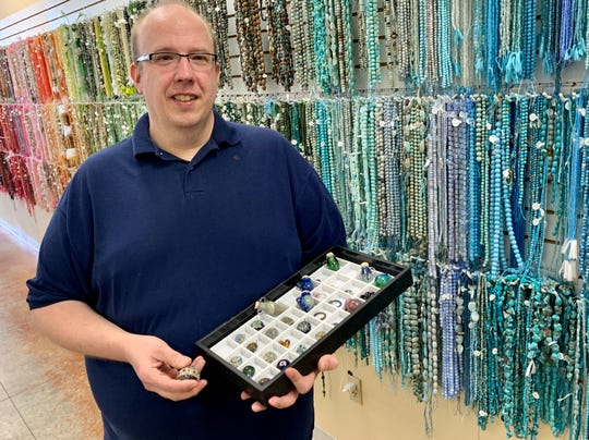 Jim Bankston displays some of the glass beads he creates and sells at Village Beads in Ridgeland. He is a member of the Craftsmen's Guild of Mississippi.
