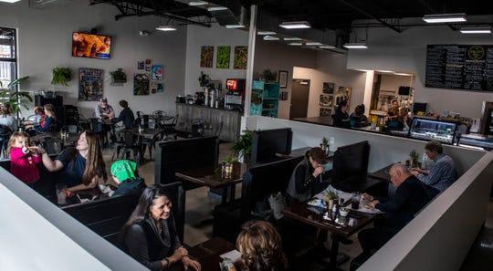 Customers dine at the new Hub City Deli in Jackson, Tenn., on Thursday, Feb. 20, 2020.