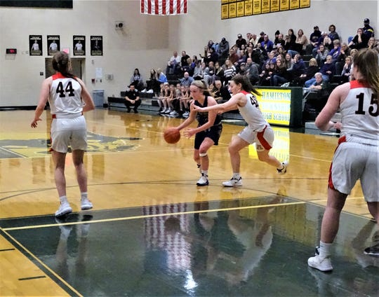 Bloom-Carroll sophomore Reese Pittman takes the ball to the basket against Jonathan Alder. The Bulldogs fell, 30-21, against the top-seeded Pioneers Tuesday night.